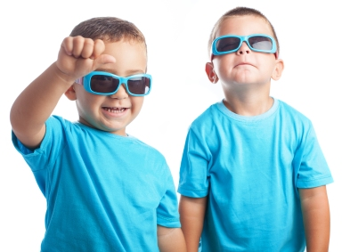 children wearing sunglasses on a white background